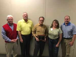 Acucote leaders celebrate Workman's Compensation award. Pictured L to R: Gene Lauffer, COO; Paul Sanborn, Senior VP of Operations; John Leath, Jr., CEO; Amy Trent, Safety Manager and Barry Brown, HR Director.